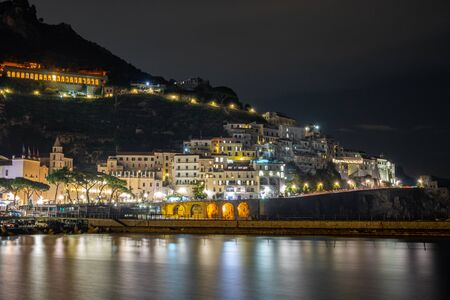 Night view of Amalfi cityscape on coast of mediterranean sea, Italy. Travel. Banco de Imagens