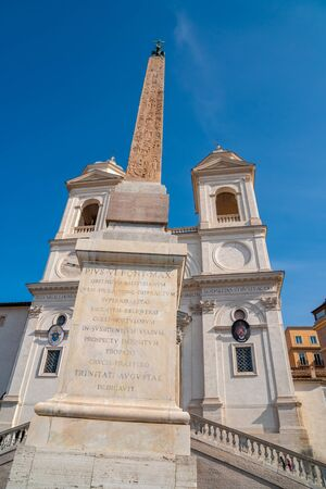 Santissima Trinita dei Monti church and Ancient Egyptian obelisk at the top of the Spanish steps in Rome. Travel.