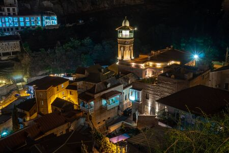 Amazing View of Jumah Mosque, Sulphur Baths and famous colorful balconies in old historic district Abanotubani at night. Tbilisi, Georgia. Travel.