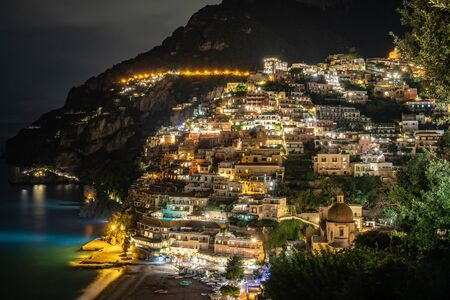 Colorful houses of Positano along Amalfi coast at night, Italy. Night landscape. Travel