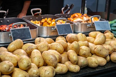 Potato and different dishes in a market. Healty food. Banco de Imagens