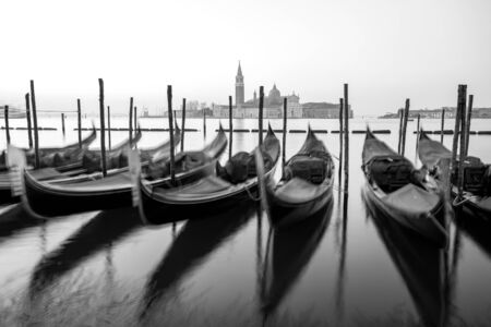 Sunrise in Venice, gondolas and island of St. George view from the square San Marco. Travel. Standard-Bild