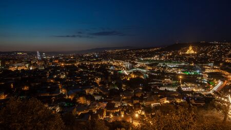 Night view of old town of Tbilisi. Tiflis is the largest city of Georgia, lying on the banks of Mtkvari River. Travel. Stock Photo