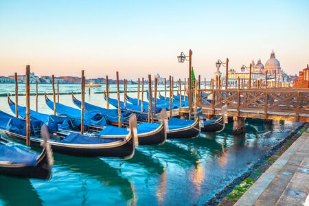 Gondolas by Saint Mark square at sunrise, Venice, Italy. Travel. Stock Photo