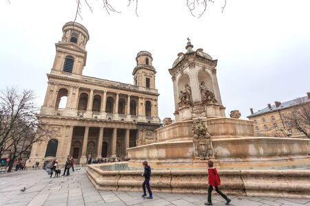Paris, France: Old Church Saint-Sulpice and the fountain in front of her in Paris. Travel.