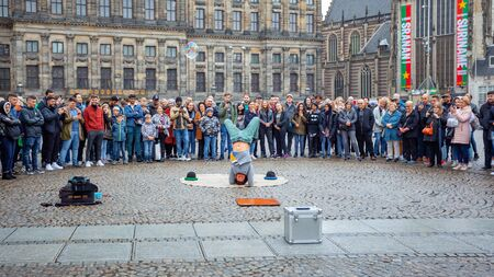 Amsterdam, Netherlands 14 October 2019 - Street acrobat at Royal Palace at the Dam Square in Amsterdam