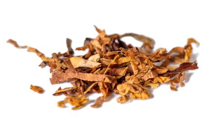 dried smoking tobacco Isolated on a white background. Macro photo.