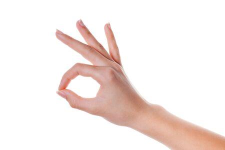 Hände nehmen Geste des okayzeichens lokalisiert auf weißem Hintergrund. Körpersprache.