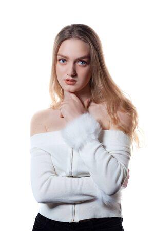 Portrait of beautiful blonde female model on white background.