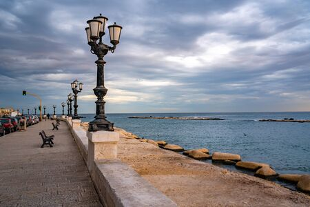 Bari seafront lights. Coastline and Twilight purple and blue sky. Mediterranean Sea. Standard-Bild - 140264721