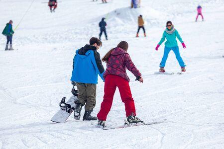 Bakuriani, Georgia February 15, 2020 - Skiers skiing climb a yoke on a mountain. Light skiing track in Bakuriani