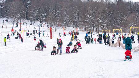 Bakuriani, Georgia February 15, 2020 - Skiers skiing climb a yoke on a mountain. Light skiing track in Bakuriani Редакционное