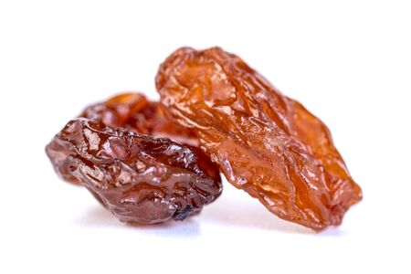 Raw raisins, dried grape isolated on white background. Dried fruit