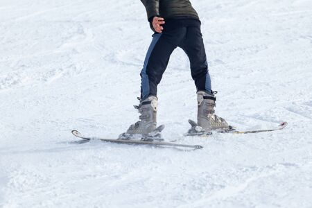 Young man on skis out of slopes, Equipment and extreme winter sports at place for skiing