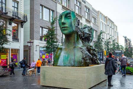 Amsterdam, Netherlands - October 14, 2019: The Modern Sculpture of a womens head near Dam Square. Art