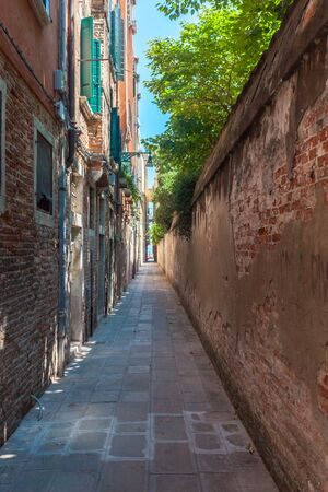 Venice's narrowest street between brick walls, Italy. Travel