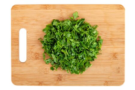 chopped parsley leaf on wooden a board isolated on white background, vegetable, top view