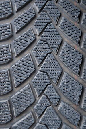 Car winter tire detail closeup, used car tires texture. Auto