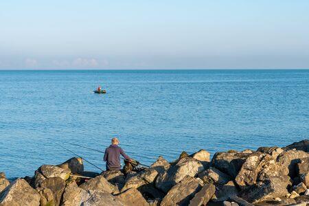 Black Sea coast in the city of Poti, fisherman in the boat. Georgia Фото со стока - 150475645