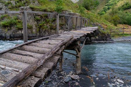 Old wooden bridge over a river Argun in Upper Khevsureti, Georgia. Travel