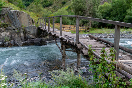 Old wooden bridge over a river Argun in Upper Khevsureti, Georgia. Travel