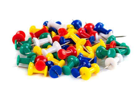 Closeup of Many Colored Thumbtacks on White Stok Fotoğraf