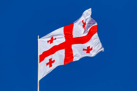 Georgia national flag waving in the wind on a blue sky