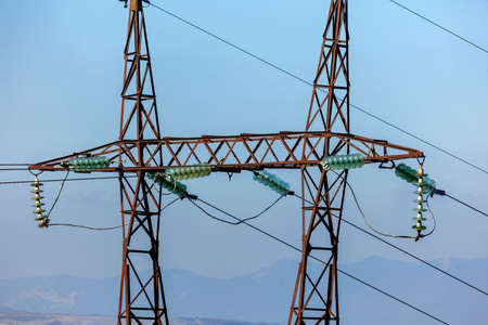 Power lines on metal poles with powerful power wires. Electrisity