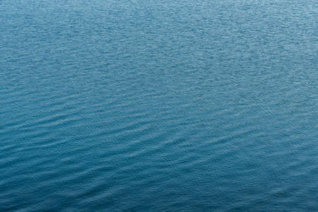 Blue sea surface with small waves. Texture. Nature