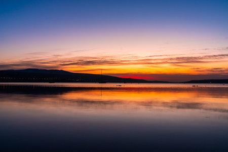 Amazing view of sunrise at Tbilisi sea, shot with long exposure 版權商用圖片