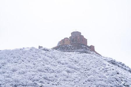View of Jvari Monastery near Mtskheta in winter. Travel Reklamní fotografie