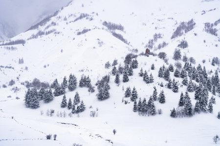 Snowy winter mountains in Georgia. Caucasus Mountains. Travel