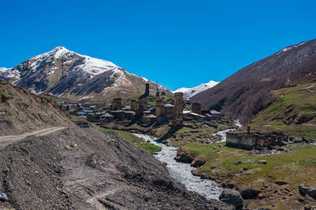 View of the Ushguli village at the foot of Mt. Shkhara. Picturesque and gorgeous scene. Rock towers and old houses in Ushguli, Georgia. Travel. Standard-Bild