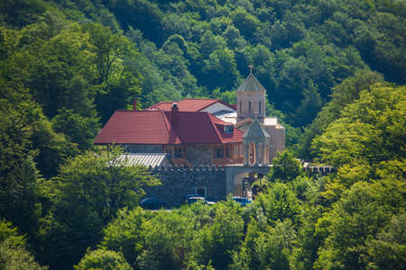 Orthodox church in Sabaduri Forest, beautiful landscape. Georgia Standard-Bild