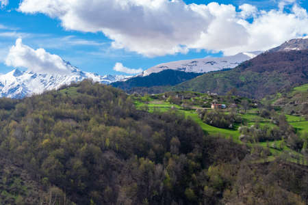 Beautiful view of small village and high mountains in upper Svaneti, Georgia. Travel