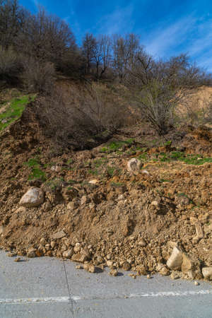 The tractor clears the road from a landslide. Svaneti, Georgia Standard-Bild