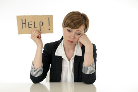 young beautiful red haired caucasian business woman overwhelmed and tired holding a help sign. looking Stressed, bored, frustrated, upset and unhappy at work. business frustration concept.