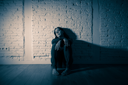 Young devastated depressed woman crying sad feeling hurt suffering depression in sadness emotion in pain and desperate expression. loneliness, depression and heartbroken concept