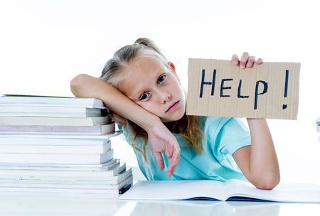 Frustrated little schoolgirl feeling a failure unable to concentrate in reading and writing difficulties learning problem attentional disorders special needs and low academic performance concept. Foto de archivo