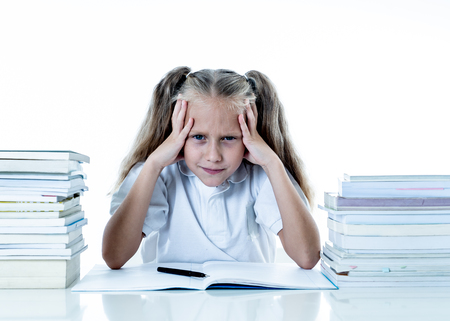 Frustrated little schoolgirl feeling a failure unable to concentrate in reading and writing difficulties learning problem attentional disorders special needs and low academic performance concept. Stockfoto