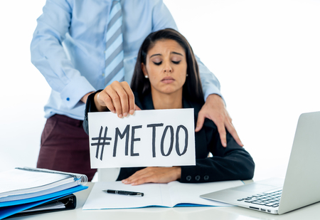 Me Too Harassment Campaign. Young businesswoman being sexually harass by her boss in the office holding a note with the text me too in stop sexual abuse women human rights concept. Foto de archivo - 110011825