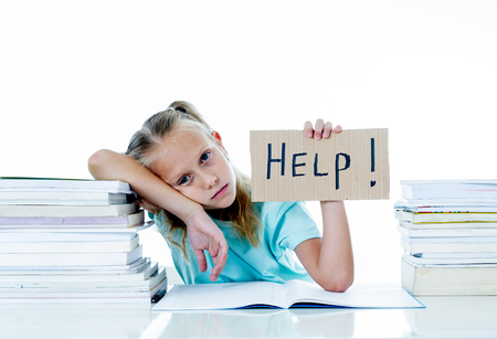 Angry little girl with a negative attitude towards studies and school having too many homework asking for help in children education concept isolated on a white background.