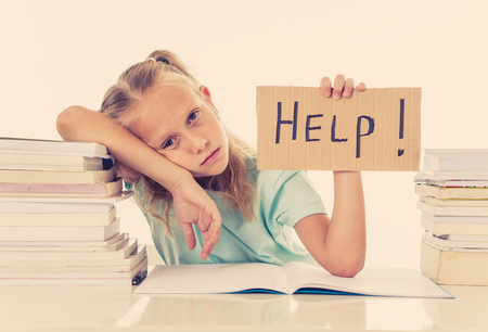 Frustrated little schoolgirl feeling a failure unable to concentrate in reading and writing difficulties learning problem attentional disorders special needs and low academic performance concept. Banque d'images