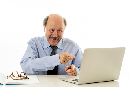Corporate portrait of happy senior business man confident and satisfied working on computer laptop office desk in Career Success job Satisfaction isolated on white background.