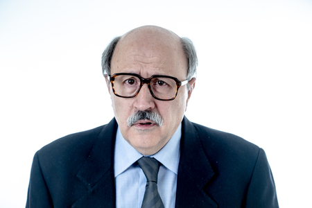 Portrait of senior mature old businessman looking sad and worried suffering pain and depression in sadness face expression Retirement and jobless concept isolated on neutral background. Banque d'images