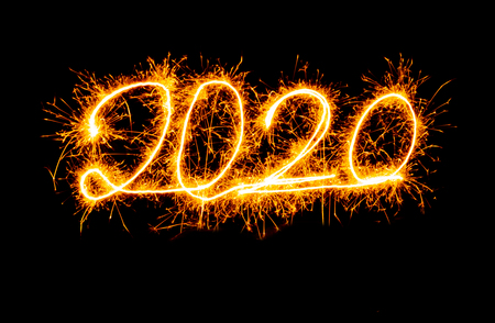 Happy New Year 2020 beautiful shining golden numbers written with sparkle fireworks isolated on black background copy space in Christmas holidays and New Year celebration and Greetings card designs.