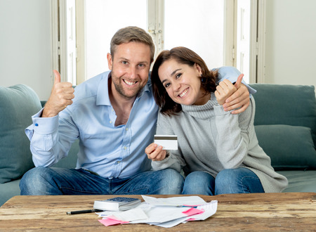 Young happy woman feeling excited about saccessful accounting home finance in savings domestic and business accountant paying bills and free of debt concept Stock Photo - 113641744