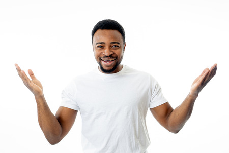 Portrait of smiling man having fun and joy smiling and laughing at the camera and pointing to something that makes him happy in Human emotions facial expressions, happiness and feelings concept.