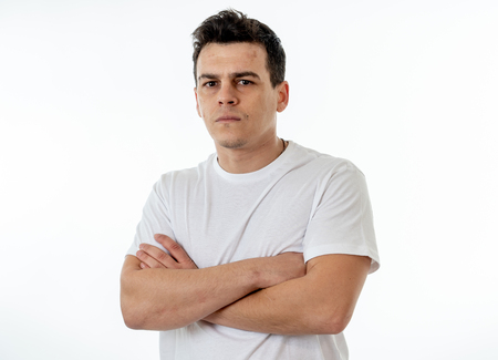 Close up portrait of an attractive young caucasian man with angry face looking furious and crazy showing teeth and fist isolated on white background. In People, Human facial expressions and emotions.