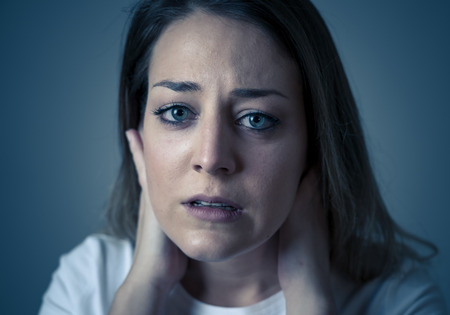 Close up portrait of beautiful young woman with sad mood looking miserable and melancholy. Human facial expressions and emotions, depression and mental health concept. Isolated on neutral background.